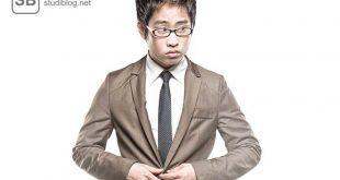 Mann im Anzug auf Status bedacht