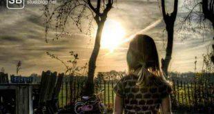 Kind steht vor seinem Rad mit Blick auf die aufgehende Sonne, zum Thema Manifesto, einer von 4 Wegen um heraus zu finden was du wirklich willst!