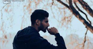 Junger Mann, der über Perfektionismus nachdenkt